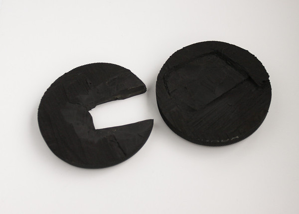 hockey puck cut in half with notches